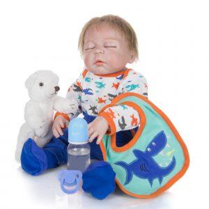 bébé reborn garçon yeux fermés avec accessoires