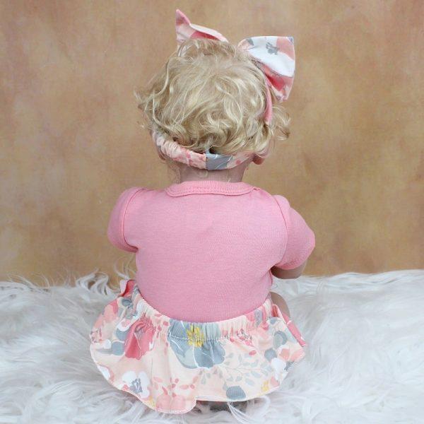 fille bébé rbeorn blonde réaliste de dos