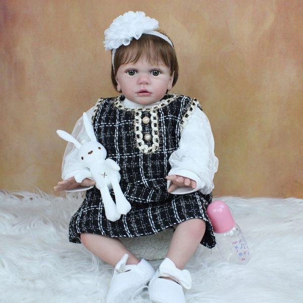 bébé reborn fille en silicone souple à adopter avec accessoires