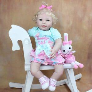 bébé reborn fille en silicone et tissu avec accessoires